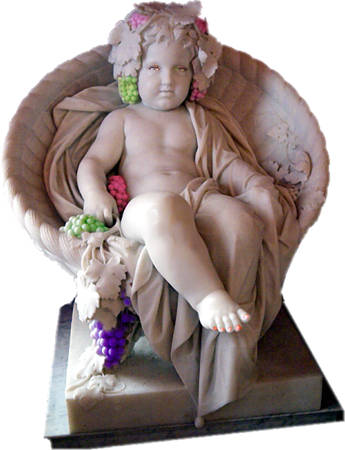 marble statue of seated child